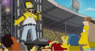 Homer nei panni di Freddie Mercuri dei Queen